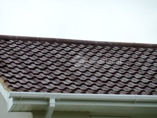 Roof tiles cleaned ,treated and coloured coating applied